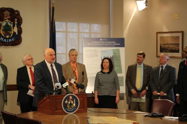 Photo of Dr. Robert Wagner presenting the SBW Task Force report to legislators.